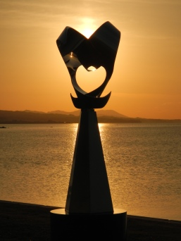 Lakeside sculpture and sunset at Shimane Art Museum