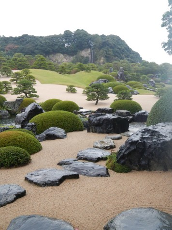 Garden with waterfall in the distance at Adachi Museum of Art