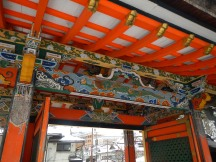 Intricate and bright paintwork on a gate (Koya)