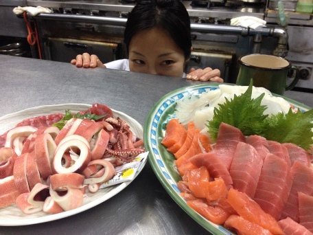 My colleague Sachie eyeing off our delicious sashimi dinner