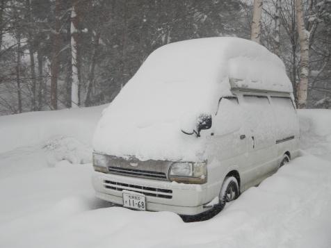 A bit of snow on the van