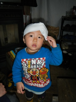 Kenta with an ice pack over a bump on his head